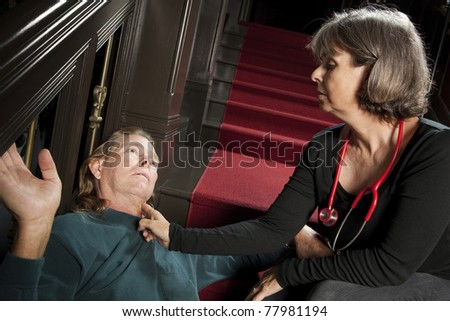 Woman checking pulse of passed out man - stock photo