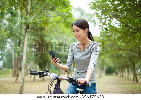 Woman checking the routine when go for cycling - stock photo