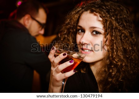 woman cheerful alone at disco club,Italy - stock photo
