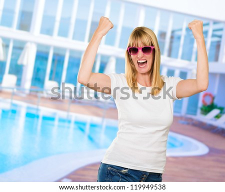 Woman Cheering by the swimming pool - stock photo
