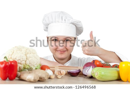 Woman chef chops vegetables for cooking