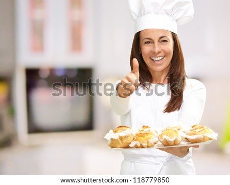 Woman Chef Holding Baked Food - stock photo