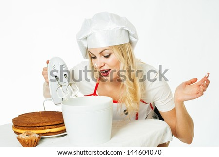 woman chef is preparing a cake