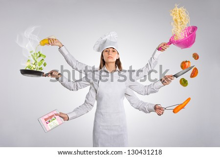 Woman chef pointing empty blank copy space isolated on white / Young woman with multiple arms - stock photo