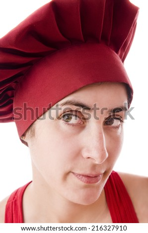 Woman chef with red hat in closeup image.