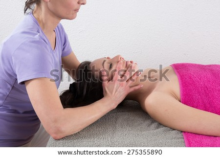 Woman chinese therapist is doing a chinese massage