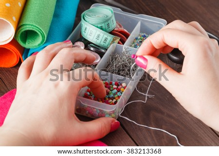 Woman choice from needle box for work