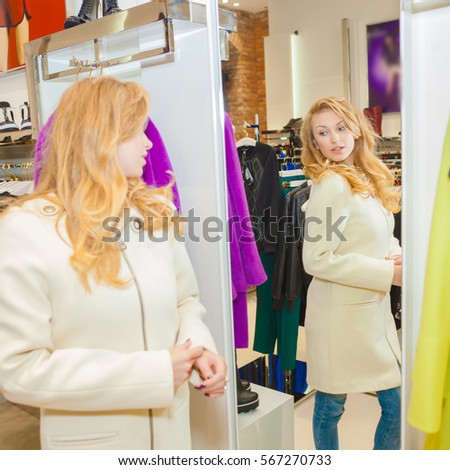 woman chooses clothes. woman in fashion shop. Girl in fashion boutique