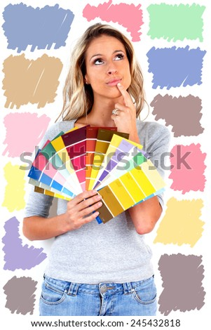 Woman choosing a color for painting. House renovation - stock photo