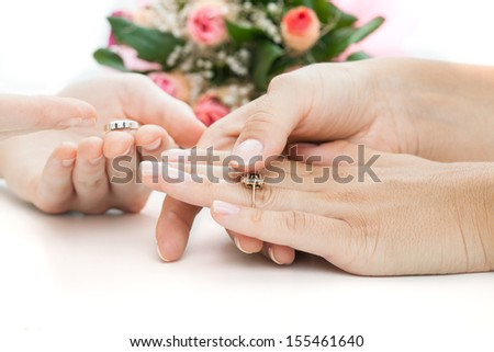 Woman choosing a rings before a proposal - stock photo