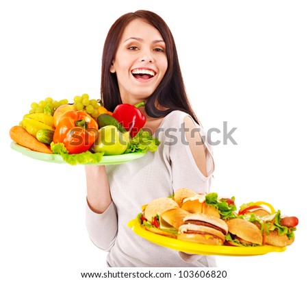 Woman choosing between fruit and hamburger. Isolated. - stock photo