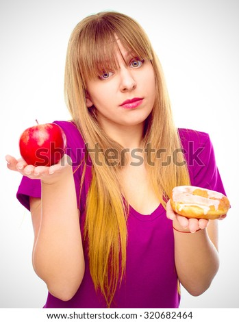 woman choosing between fruit and sweets , isolated over white