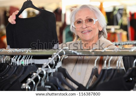 Woman choosing clothes - stock photo