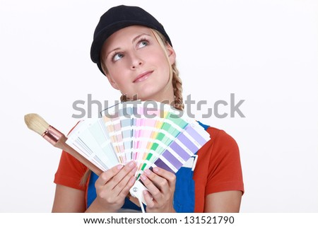 Woman choosing color on swatches - stock photo