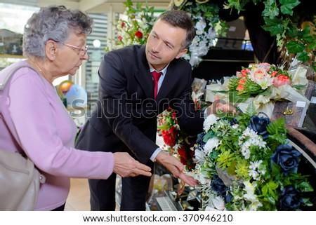 woman choosing flowers - stock photo