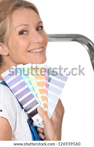 Woman choosing paint color - stock photo