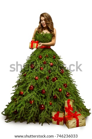 Woman christmas tree dress present gift stock photo 746236033 woman christmas tree dress and present gift fashion model in new year gown isolated over negle Gallery