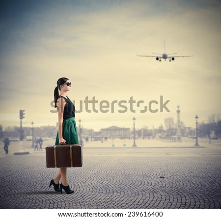 Woman classy traveller walks in a square - stock photo