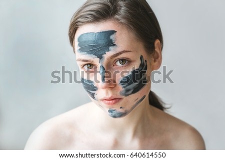 Woman clay face mask peeling natural portrait