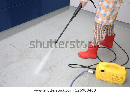 Woman cleaning a floor