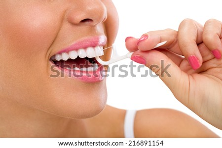 woman cleaning flossing using f-shaped dental wand