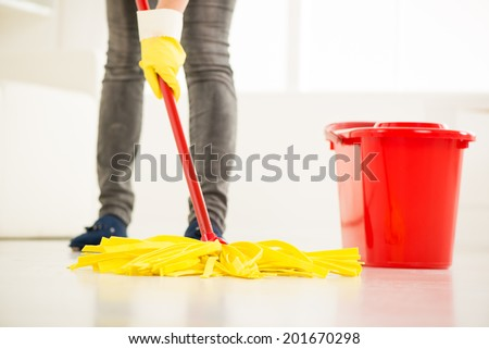 Woman cleaning the house. Close-up with mop. - stock photo