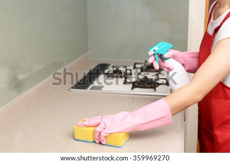 Woman cleaning the kitchen - stock photo