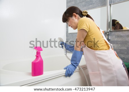 woman cleaning up bathroom