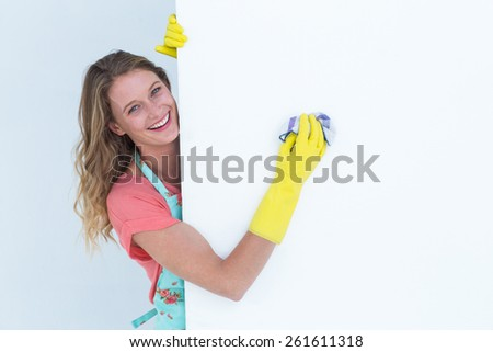 Woman cleaning white poster on white background