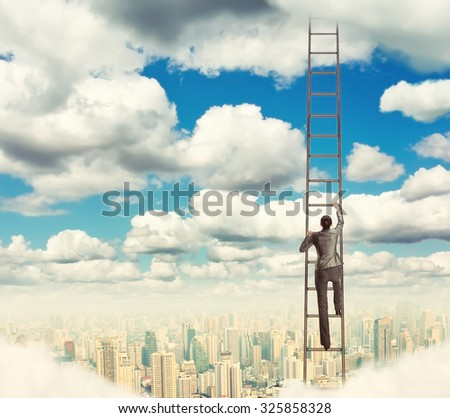 Woman climbing the ladder - stock photo