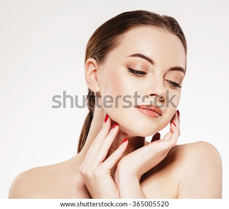 Woman close-up beauty portrait hands touching face on white background  - stock photo