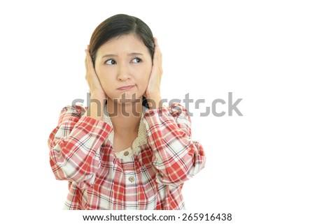 Woman closing ears. - stock photo