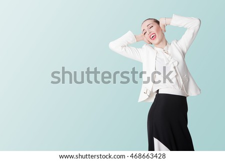 WOMAN CLOSING EARS. Young woman on white isolated background in bright clothing.