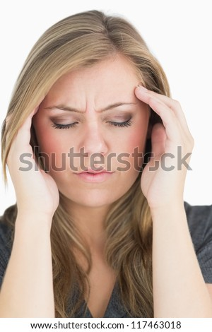 Woman closing her eyes in the white background