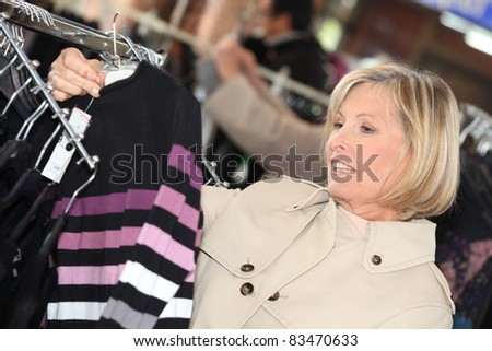 Woman clothes shopping - stock photo