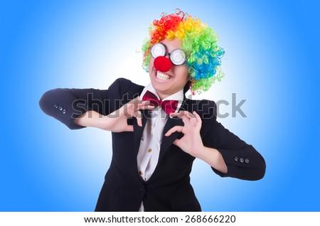 Woman clown businesswoman isolated on white - stock photo
