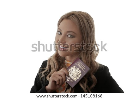 Woman clutching a passport in anticipation of the freedom of adventure and travel in foreign countries and tourist destinations - stock photo