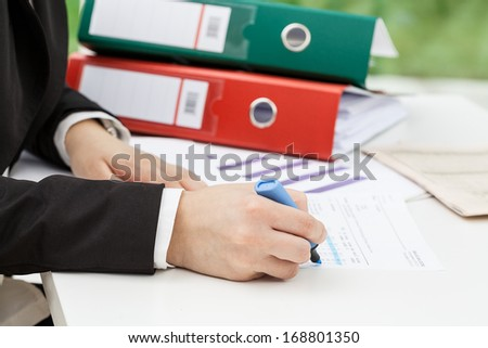 Woman collecting data for his report, closeup