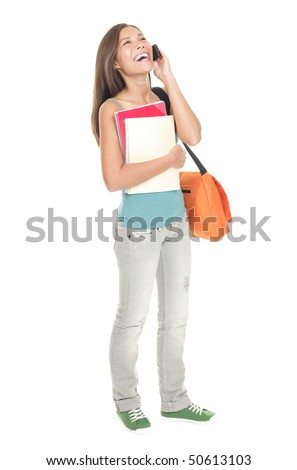 Woman college student standing isolated in full length. Mixed race Asian Chinese / caucasian. Female university student talking in mobile phone. Cutout isolation on white background. - stock photo