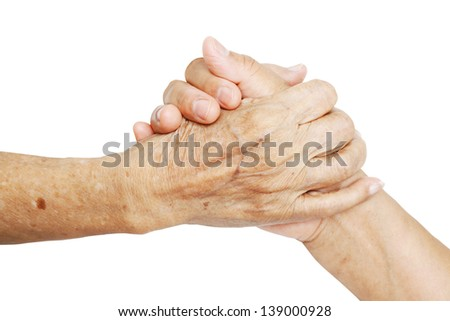 Woman Comforting Hand with Old woman isolated on white background - stock photo
