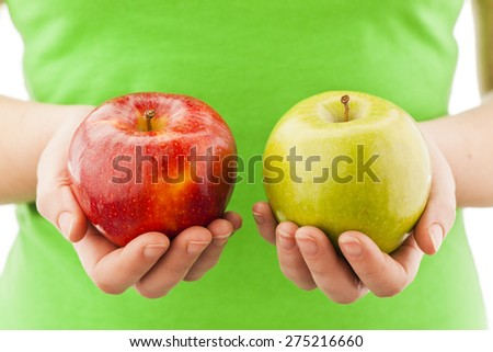 Woman comparing green and red  apple Choice concept - stock photo