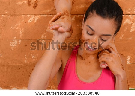 Woman competing in a mud run race - stock photo