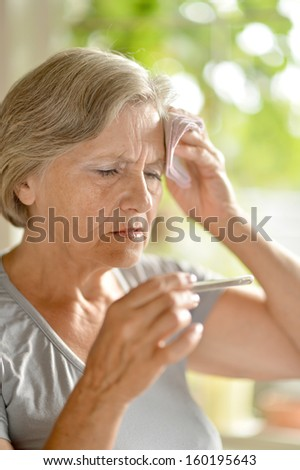 Woman complaining of a high temperature