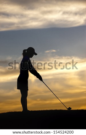Woman concentrating on ball. - stock photo
