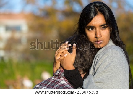 Woman consoling her unhappy boyfriend or husband - stock photo
