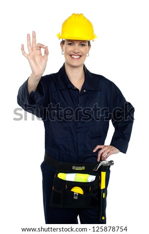 Woman construction worker at her best gesturing perfect sign to the camera. - stock photo