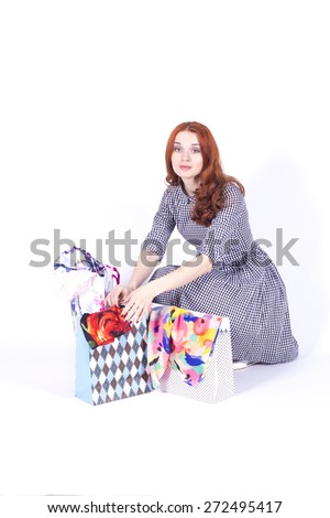 Woman contemplates gift bags