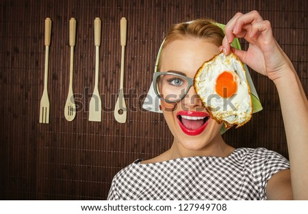 woman cook holding pan with fried egg - close up - stock photo