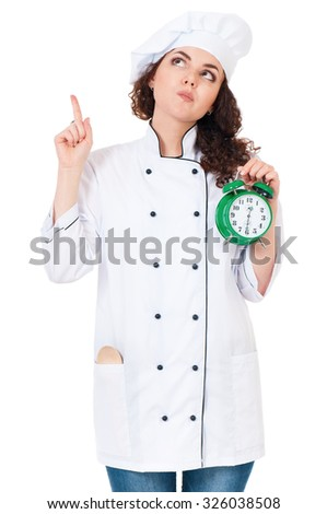 Woman cook in chef hat with alarm clock, isolated on white background. - stock photo