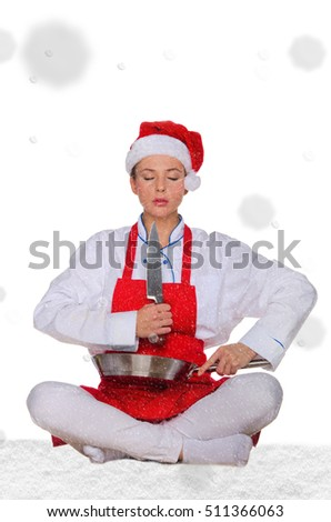 Woman cook in Santa hat, yoga, knife under snow on white background